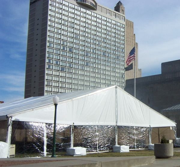 sideview of LT&A SUPER TENT&#174 with covered weights a Kansas City tent rental