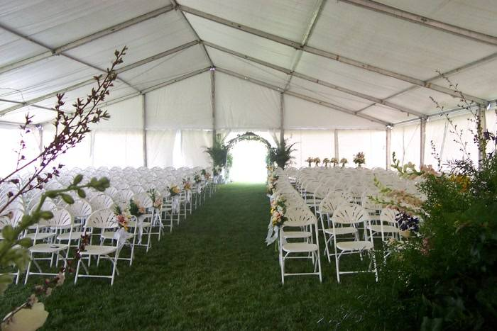 View Of A Tent Set To Hold Simple But Beautiful Outdoor Wedding