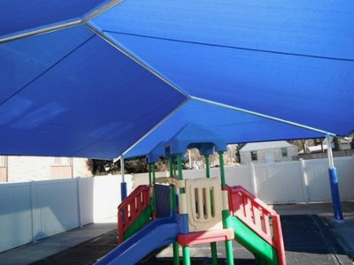 Image of a shade cover over a playground area.