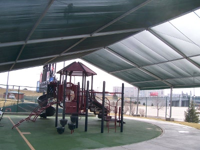 Image of inside shade structure over playground.