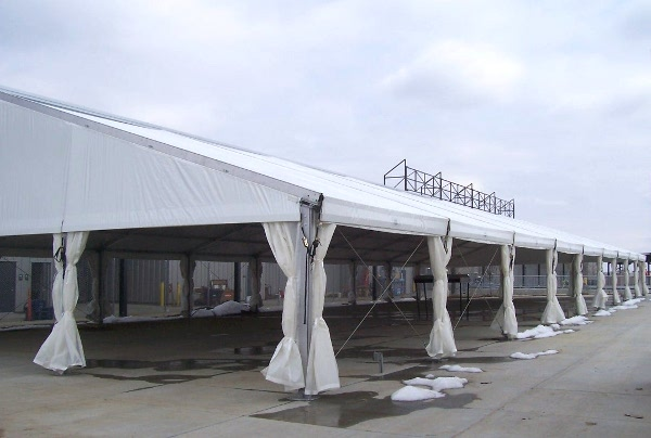Image of a permanent pavillioni giving shade cover for serving area