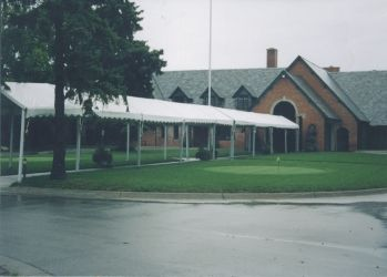Image of walkway tent covering entry walk to building