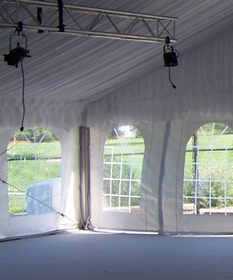 view of covered weights from inside of tent